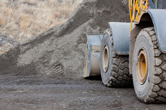 Loader by Gravel Pile Royalty Free Stock Photos