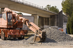 Loader and Gravel Under Bridge Royalty Free Stock Photography