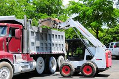 Loader loading truck in Florida parking lot Royalty Free Stock Photography