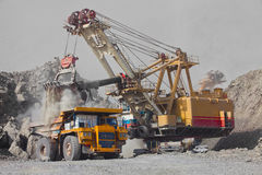Excavator and truck in mine Royalty Free Stock Photos