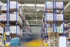 Loader machine moves in warehouse of Caparol factory Stock Photos