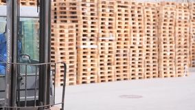 Loader manages an electric forklift stock footage
