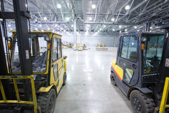 Loader in modern storehouse Royalty Free Stock Photos