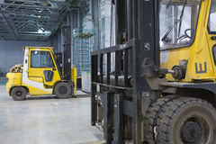 Loader in modern storehouse Royalty Free Stock Image