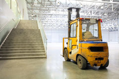 Loader in modern storehouse Royalty Free Stock Images