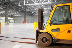 Loader in modern storehouse Stock Images