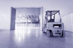 Loader in modern storehouse Stock Images