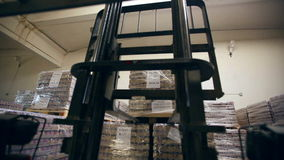 Loader removes pallets in stock.  stock footage