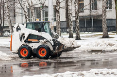 Loader removes snow Stock Photo