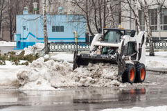 Loader removes snow Royalty Free Stock Photos