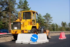Loader on road. Yellow loader is building new road in Russia Stock Photography