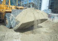 Loader with sand in the bucket. Loader with sand in bucket on the construction site stock photos