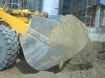 Loader with sand in the bucket Royalty Free Stock Images