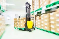 Loader stacker at warehouse Royalty Free Stock Images