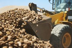 Loader and Stones on Quarry royalty free stock photography