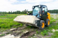 The loader took the sand into the bucket for construction work. Copy paste royalty free stock photography
