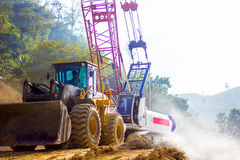 Loader truck and mobile crane is coming up hill Royalty Free Stock Photo