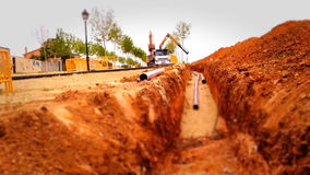 Loader truck working in a construction site, tilt shift effect stock video footage