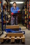 Loader using hand pallet truck Stock Photo