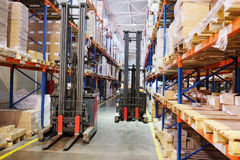 Loader in a warehouse stock photos