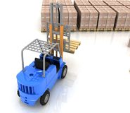 Loader in warehouse with pallet Royalty Free Stock Image