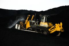 Loader working on coal loading royalty free stock photos