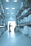 Loader working  in a warehouse. Blur Royalty Free Stock Image