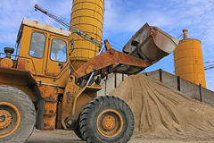 Loader works with gravel and sand Stock Photo