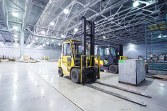 Loaders in modern storehouse Royalty Free Stock Photography