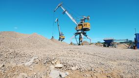 Loaders are relocating ground rubble. 4K stock footage