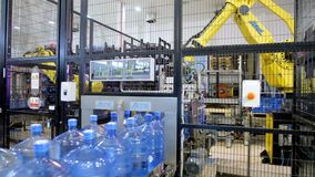 Loaders transport bottles with pure water in warehouse. stock video