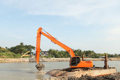 Loaders working in the middle of the river. Royalty Free Stock Photos