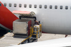 Loading... Worker loading cargo in the plane Royalty Free Stock Photos