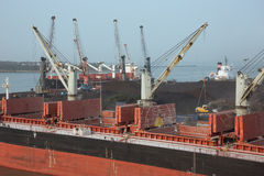 Loading activities on cargo ships. In the Port of New Mangalore stock photo