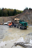 Loading aggregate in the quarry. Loading rock aggregate in the quarry Royalty Free Stock Photography