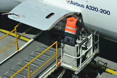 Loading an Airbus A320 Royalty Free Stock Image