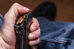 Loading 5.56 ammo magazine for machine guns Stock Photos