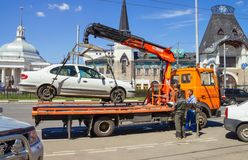 Loading of automobile car on wrecker for parking infringement in Stock Photo