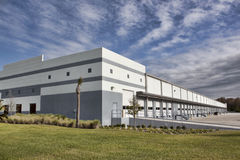 Loading Bay Doors. New warehouse space left empty by the economic downturn. Image shows the exterior of the building, including multiple closed and idle loading stock photos
