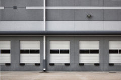 Loading Bay Doors. Of a new warehouse space left empty by the economic downturn. Image shows the exterior of the building, including multiple closed and idle Stock Photos