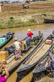 Loading the boat. Boats are loaded with the goods from the market Stock Image