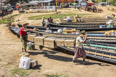 Loading the boat. Boats are loaded with the goods from the market Stock Photography