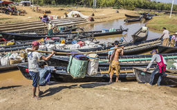 Loading the boat. Boats are loaded with the goods from the market Stock Images