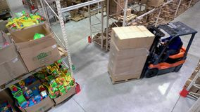 Loading Boxes in Warehouse, Forklift Rides. Composition Returns to Right stock footage