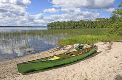 Loading the Canoe on Shore Royalty Free Stock Image