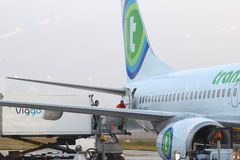 Workers are loading cargo in a Dutch Transavia plane,Eindhoven airport, Netherlands Royalty Free Stock Photo