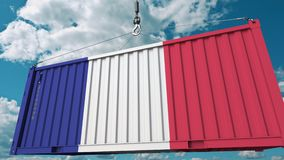 Loading cargo container with flag of France. French import or export related conceptual 3D animation. Loading cargo container with flag. Import or export related stock video