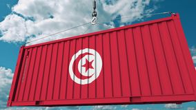 Loading container with flag of Tunisia. Tunisian import or export related conceptual 3D animation. Loading cargo container with flag. Import or export related stock video footage