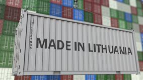 Loading container with MADE IN LITHUANIA caption. Lithuanian import or export related loopable animation. Loading cargo container. Import or export related stock footage