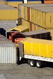 Loading cargo containers from trucks Royalty Free Stock Photos